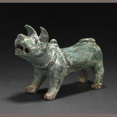 Green Glazed Pottery Model f a Barking Dog, Han Dynasty-bonhams.com