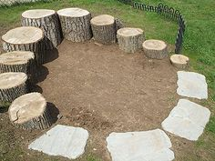 A natural playground- Climbing logs around a sandbox area.  Instead of pavers in front use boulders.