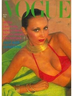 May 1976 British Vogue cover on the beach with full 70's makeup and natural breasts on a model.