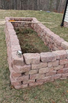 Brick Raised Vegetable Beds | Once all of the stones were in place, we draped each garden bed with ...