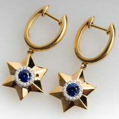 The earrings feature a star design, centered with a round mixed cut sapphire in a four-prong setting, surrounded by a halo, scallop set with sixteen round brilliant cut diamonds. The earrings measure long by wide, finished with posts an Sapphire Earrings, Sapphire Diamond, Blue Sapphire, Dangle Earrings, Gold Jewelry, Jewelery, Vintage Jewelry, Fine Jewelry, Star Designs