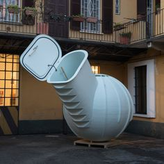 This globe-shaped Groundfridge by Dutch designer Floris Schoonderbeek is intended to be buried underground, keeping food cool without using electricity