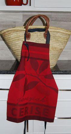 Cheery Gereziak cherries adorn this jacquard children's apron.