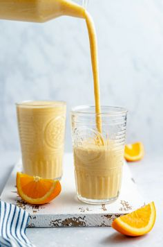 Refreshing orange creamsicle smoothie that tastes just like the summer treat you grew up on! This simple and delicious orange smoothie recipe is made without banana, naturally sweetened and has a sneaky boost of veggies. You'll make this one all year long! #smoothie #orange #healthybreakfast #healthysnack Yummy Smoothie Recipes, Good Healthy Recipes, Yummy Drinks, Paleo Recipes, Orange Smoothie, Fruit Smoothies, Dairy Free Greek Yogurt, Orange Creamsicle, Orange Recipes