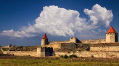 The fortress of Tighina was built in the important trade outpost of medieval Moldova. Travel and discover the beautiful country of Republic of Moldova. Historical Architecture, Ancient Architecture, Castle House, The Beautiful Country, Moldova, Medieval Castle, Old Buildings, Romania, Monument Valley