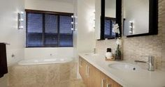 Fresh air and sunlight permeate the living spaces of The Quindalup creating a home unmatched for warmth and positivity. Home, Corner Bathtub, Custom Homes, House Design, Bathroom Inspiration, Building Companies, New Home Designs, New Homes, Living Spaces