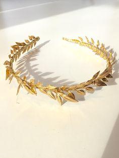 A personal favorite from my Etsy shop https://www.etsy.com/listing/219509364/gold-leaf-headband-leaf-headdress