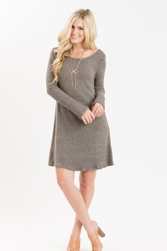 Who doesn't love a sweater dress? These are soooo easy to style and throw on when you're on the go and want to look effortlessly cute! We love how cozy this sweater dress keeps you paired with your co