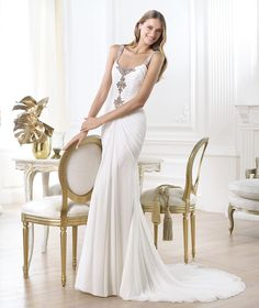 Pronovias - 2014 FASHION / Lainey Style Draped gauze wedding dress with vintage gold embroidery in the centre. Round neckline with draping and gemstone embroidered straps. Mermaid skirt with draping in the centre.