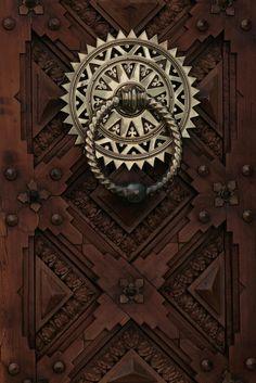 Door II by frustrated.artist, via Flickr...door knocker in Zaragoza, Spain
