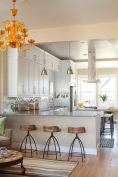 White kitchen with rustic barstools