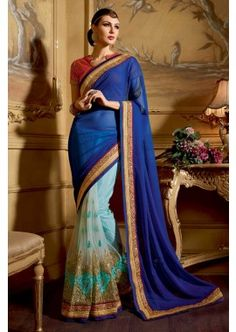 Blue net half and half sari. This sari is beautified with heavy floral embroidery and embroidered lace border work. It comes with a matching embroidered unstitched blouse. Designer Sarees Wedding, Indian Designer Sarees, Latest Designer Sarees, Saree Wedding, India Wedding, Wedding Wear, Wedding Gowns, Latest Indian Saree, Indian Sarees Online