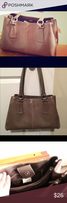 Beige Liz Claiborne Shoulder Bag Gently used light brown/beige Liz Claiborne shoulder bag. 14 inches long, 9 inches tall, 5 inches wide at base. 3 inner sections divided by two large zippered pockets. Strap drop is 10 inches. Magnetic button closure. Liz Claiborne Bags Shoulder Bags