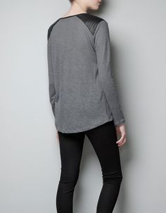 Shirt with faux leather shoulders from Zara.