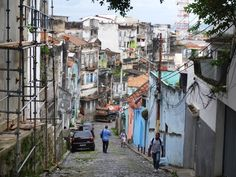 In preparation for the upcoming World Cup and Olympics, the Rio de Janeiro City Government is in the process of evicting thousands of residents of Providência, the oldest favela in Rio de Janeiro. Favela is the Brazilian word for a neighborhood that is. City Government, The Neighbourhood, Travel Destinations, Rio Brazil, Old Things, Bike, Adventure, Cops, World