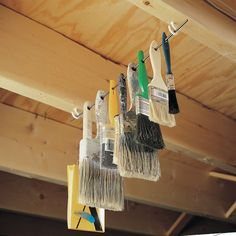 Woodworking Jigs Out-Of-The-Way Paint Brush Storage - Hang your paint brushes up out of harm's way by installing a couple of screw eyes or cup hooks on the bottom of a couple of rafters or floor joists. Storage Shed Organization, Garage Organisation, Garage Tool Storage, Paint Storage, Workshop Storage, Garage Tools, Garage Workshop, Diy Storage, Organizing