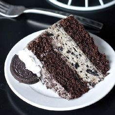 Oreo cheesecake sandwiched between two layers of delicious chocolate cake smothered in Oreo frosting with more on top!