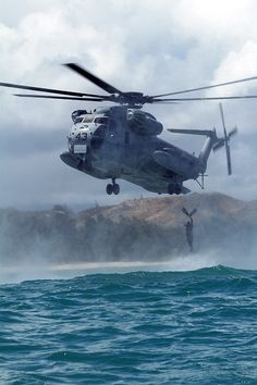 CH-53 performing a helocast insertion during training off Hawaii. CH-53 Sea Stallion is the most common name for the Sikorsky S-65 family of heavy-lift transport helicopters. Originally developed for use by the United States Marine Corps, it is in service with Germany, Iran, Israel, and Mexico.