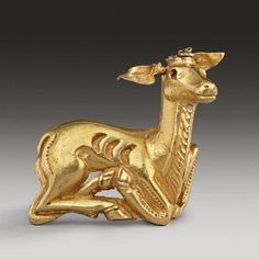 Scythian gold animal in the form of a stag, 400-200 B.C. 4.9 cm long. Private collection