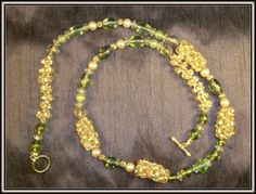 beaded amber, green and gold necklace