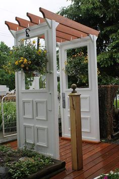 The two posts on this site with the doors are great! That little door pergola would be super cool at the top of the three stairs leading up to our fire pit area!