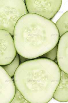 Close up fresh green sliced cucumber ...  background, chopped, close-up, color, copy, cross, cucumber, dieting, dinner, eating, food, fresh, freshness, green, group, healthy, horizontal, image, ingredient, isolated, life, macro, natural, nobody, nutrient, nutrition, object, organic, part, portion, raw, refreshment, ripe, section, shot, single, slice, still, studio, vegetables, vegetarian, white
