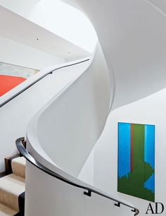 To unify a disjointed Manhattan penthouse, interior designer Delphine Krakoff conceived this unique snaking plaster staircase, which was realized by architect Mark Ferguson of Ferguson & Shamamian.Extraordinary Staircases