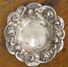 sterling silver repousse tidbit dish with lotus decoration