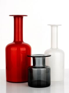 Three Glass Vases one opaque red with white interior, one opaque white, one clear blue, blue etched to base 'HOLMEGAARD 19R62'