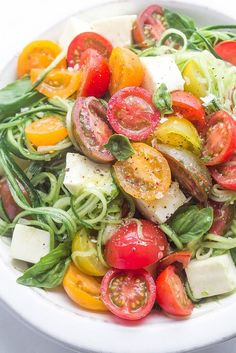 Cucumber Caprese Salad. If you love caprese and you're a fan of zoodles, this fresh take is about to blow your mouth straight to happy. Cucumbers are noodlized and then tossed with tomatoes, mozzarella and basil for a delish side you can make in minutes.