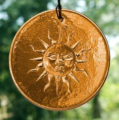"Sunbeams Suncatcher - Amber - Smiling sun face will add warmth and color to any room. Made of solar yellow glass. Approx. 4"" in diameter. Comes with a hemp cord and glass beads for hanging. #Suncatchers # #GryphonsMoon"