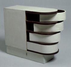 Eileen Gray; Lacquered Wood Cabinet with Swivel Drawers, 1926-1929.