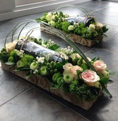 Wine Bottle Surrounded in a Floral Arrangement Arte Floral, Deco Floral, Floral Design, Ikebana, Floral Centerpieces, Floral Arrangements, Centrepieces, Wedding Centerpieces, Fresh Flowers