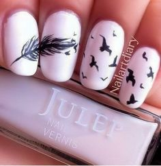 pastel pink nails with cute bird and feather design
