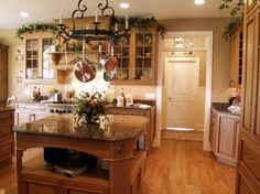 Greenery above kitchen cabinets ideas in natural finish wood cabinets | Decolover.net