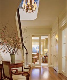 Mariette Himes Gomez. soft creamy walls. simple warm woods. elegant foyer