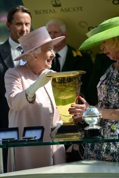 Queen Elizabeth II presents The Diamond Jubilee Stakes award to horse owner Mrs S. Power during day five of Royal Ascot 2014