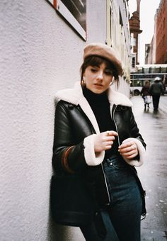 Autumn/Winter: Camel beret + black polo neck + dark high waist jeans + black leather and white faux sherling jacket