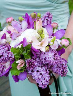 Shades of purple...spring bridesmaid bouquet. Lush and abundant.  Mokara orchids,ranunculus,fragrant lilac.