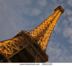 Artificially illuminated Eiffel tower during the blue hour after sunset.