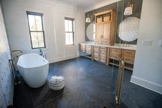 An organic concept with a ton of fun 🤩 On the floors of this coastal Carolina bathroom the #gardenstatetile Ardosia collection brings in the elegance and simplicity of Brazilian slate while the Striped Hex collection introduces a lively accent to the walls. Bathroom Design Inspiration, Slate, Floors, Coastal, Walls, Concept, Organic, Elegant, Grey