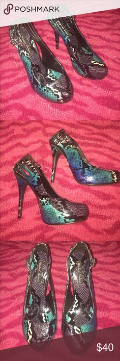 Brand new Sz 7.5 Snake print heels Beautiful brand new blue, real, black and silver snake print almond toe heels with cut out and buckle details Michael Antonio Shoes Heels