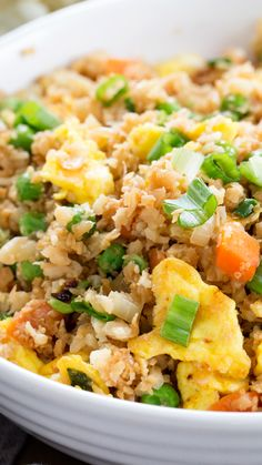 Tasty cauliflower fried rice is the low carb, Paleo recipe that satisfies your craving for takeout. Learn to make riced cauliflower the easy way with frozen, defrosted cauliflower. http://glutenfreeonashoestring.com/