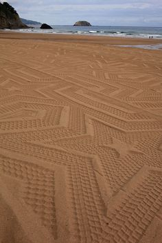 Artistic Tractor Imprints Intricate Patterns on the Beach - My Modern Metropolis