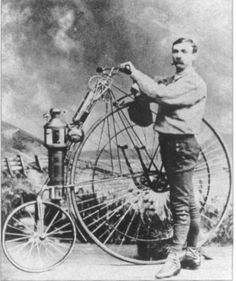 Lucius Copeland with an early motorcycle, 1894.
