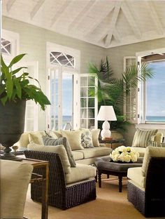 Wicker side chairs in a coastal living room