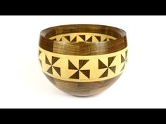 frank howarth - This video is of a wood turned segmented walnut and maple bowl inspired by traditional tapa cloth patterning. I did this video all with a stop motion technique trying to remove myself from the story in order to make the materials, process, and product the stars of the show.
