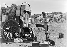 The Matador Wagon Cook [Harry Stewart] Making a Cobbler. Matador Ranch, Texas., 1908  Gelatin dry plate negative