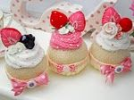 A trio of my knitted cupcakes with hand made felt fruit