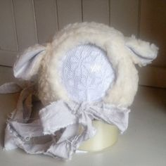 A beautiful lamb bonnet, ideal for easter shoots or anytime. Made from faux fur, with long ties with gorgeous inner ear fabric, its sure to be a favourite with the parents. If buying within made to order options, please allow 2-3 weeks turnaround time. ***These Bonnets are MADE TO